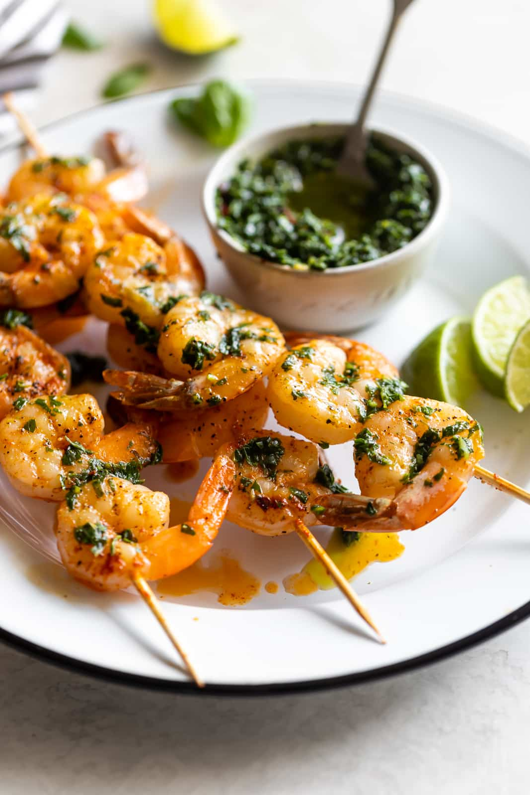 Flavorful, easy-to-make shrimp skewers made with a fresh, homemade basil chimichurri. A great appetizer or main dish ready in less than 15 minutes!