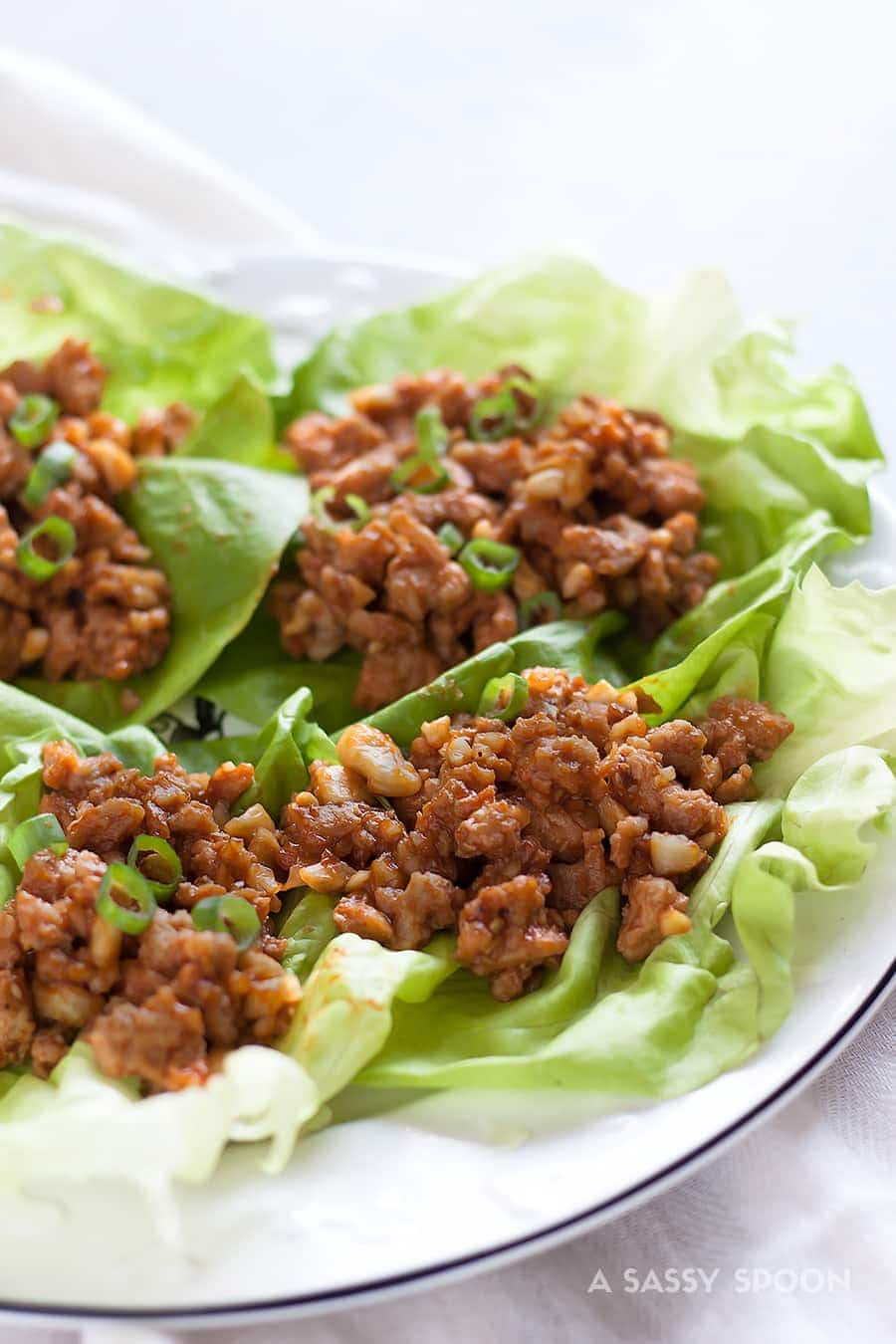 Cashew Basil Chicken Lettuce Wraps. Ground chicken with sweet hoisin sauce, salty soy sauce, crunchy cashews, scallions, and fresh basil. Dinner can't get more deliciously healthy than this!