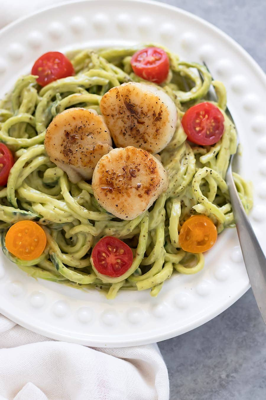 Zucchini noodles topped with a creamy avocado sauce and seared scallops. No dairy, no preservatives, no added sugars, andabsolutely delicious!