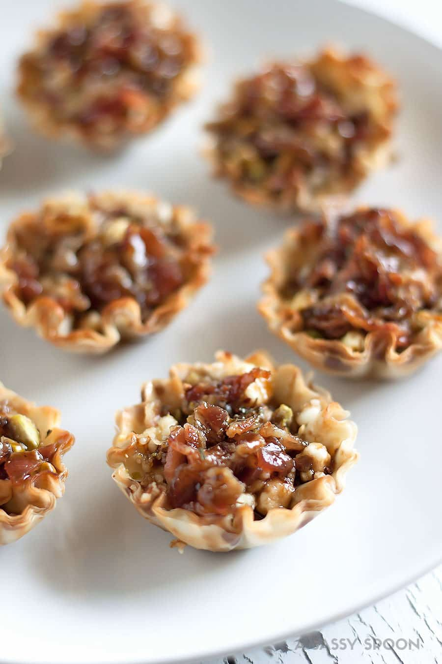 Bacon and goat cheese bites served in mini phyllo cups