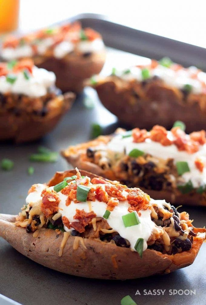 Crispy sweet potato skins loaded with gouda, chorizo, black beans, sour cream and scallions! Perfect for a weeknight meal, side dish, or game day!