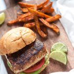 Blackened mahi-mahi sandwich served with sweet potato fries