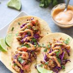 Easy-to-make spicy fish tacos with pan-fried white fish, slaw, and chipotle mayo. A healthier alternative to fried fish tacos ready in just 15 minutes!