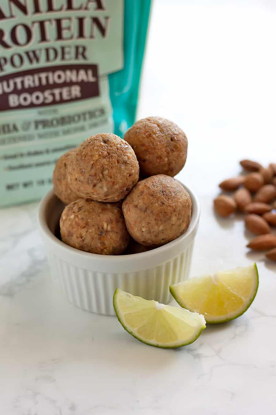 key lime pie protein balls in a ramekin with key lime slices
