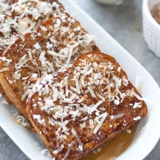 Dairy free French toast made with coconut milk, spiked with rum, and topped with toasted coconut flakes. Perfect for special occasions or Sunday brunch!