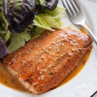 Insanely easy-to-make and flavorful honey mustard salmon ready in less than 15 minutes! Perfectly simple weeknight dinner!
