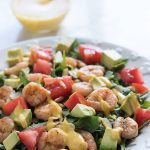 Give this simple shrimp, avocado, tomato salad a tropical twist by adding a deliciously creamy homemade mango mojito dressing! Don't forget the almonds for some added CRUNCH.