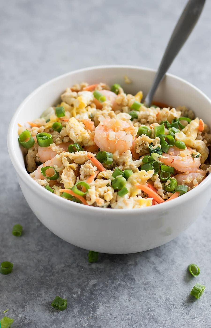 Forget takeout. Make Cauliflower Shrimp Fried Rice at home using riced cauliflower, carrots, peas, onions, garlic, and coconut aminos in just 15 minutes!