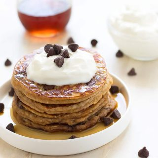Fluffy, healthy, grain-free, dairy-free, refined sugar free, low carb chocolate chip pancakes made with almond flour, raw honey, and dark chocolate chips!