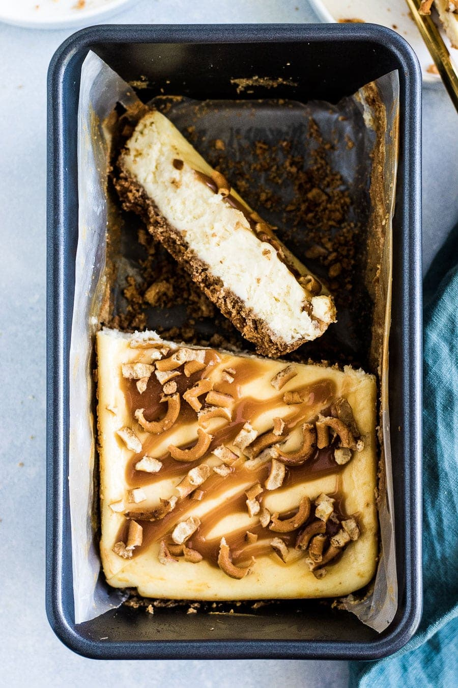 Deliciously creamy, small batch salted caramel pretzel cheesecake made with graham crackers, pretzels, and salted caramel.