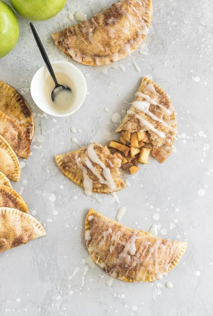 These baked apple pie empanadas with a buttery brown sugar apple filling and a spiced rum icing drizzle are the perfect party snack!