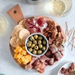A beautiful cheese board is always impressive. Make it a next level cheese board by adding bacon wrapped dates, marinated olives, and candied mixed nuts!