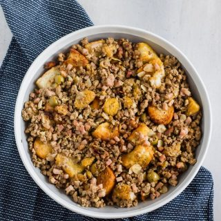 Cubes of toasty French bread mixed with ground beef, ground pork, diced ham, herbs, spices, sliced almonds, chopped olives, and sweet plantains! The BEST stuffing you'll ever try!