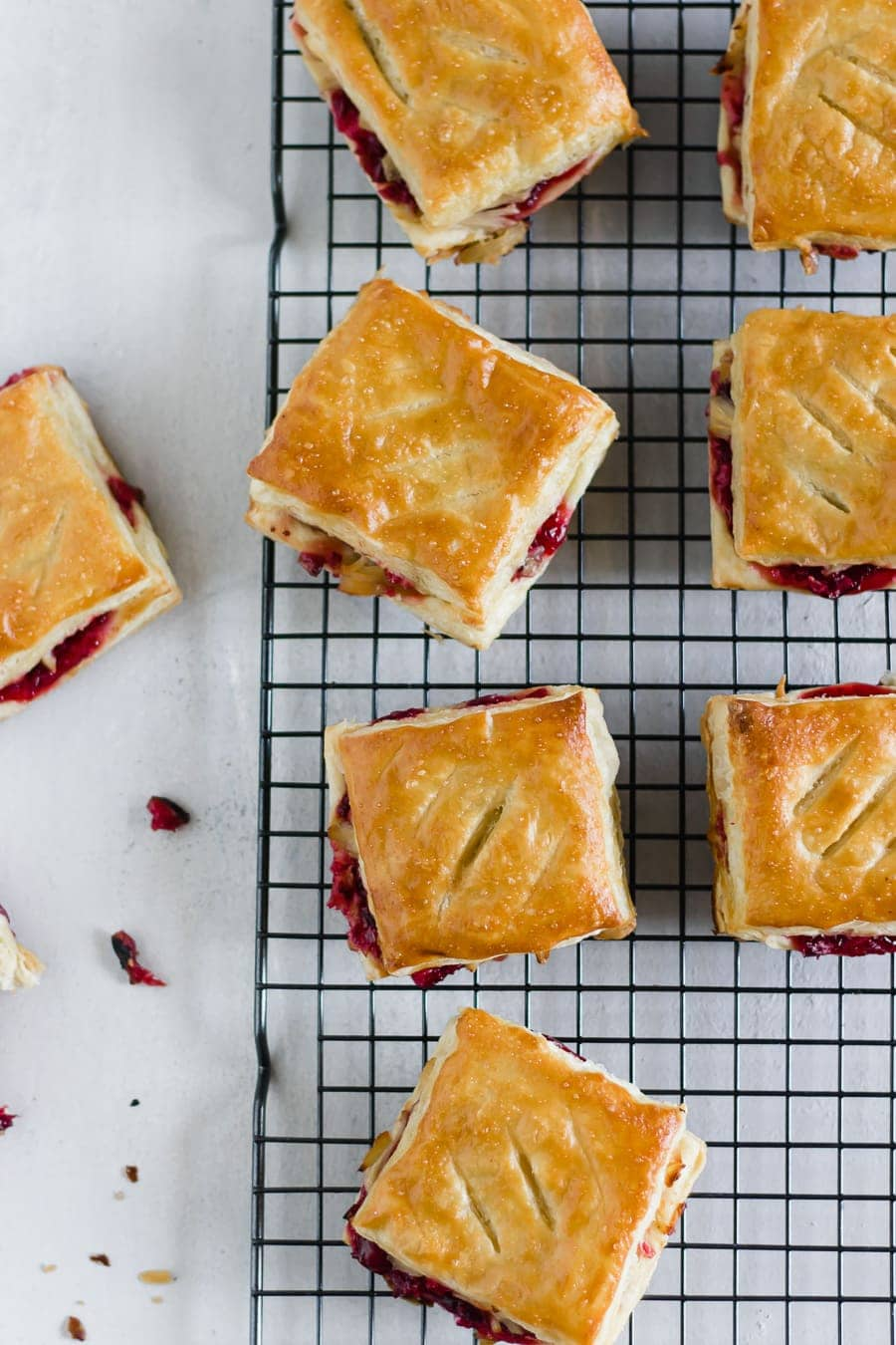 Leftover Cranberry + Turkey Pastries. Repurpose Thanksgiving leftovers by making savory sweet pastelitos (aka pastries or hand pies) using puff pastry sheets!