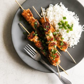 Salmon marinated in honey, garlic, soy sauce, fresh lime juice then cooked on skewers for 10 minutes in a cast iron skillet. A simple yet gourmet weeknight meal!