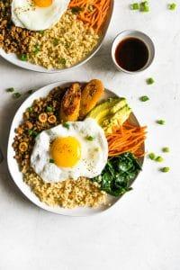 Inspired by Korean bibimbap, this healthy-ish Cuban bibimbap bowl has ground turkey (picadillo), seasoned cauliflower rice, sautéed garlic spinach, carrots, avocado, and sweet plantains. Colorful, flavorful and delicious!