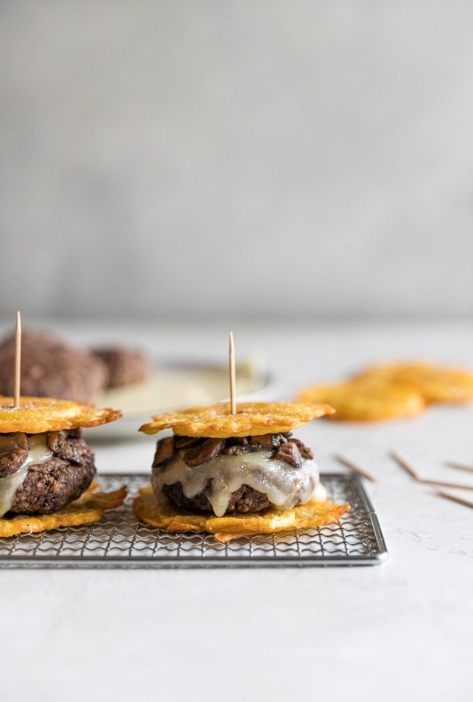 Flavorful black bean burgers topped with melted Swiss cheese and sautéed mushrooms with two twice fried plantains as buns. A delicious Cuban twist on a veggie burger!