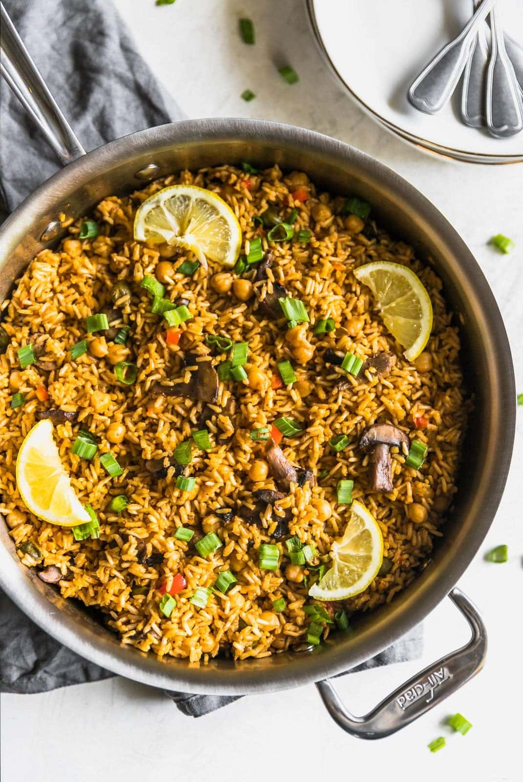 One pan quick easy vegetarian paella a sassy spoon a quick and easy vegetarian paella made with brown rice garbanzo beans mushrooms forumfinder Choice Image