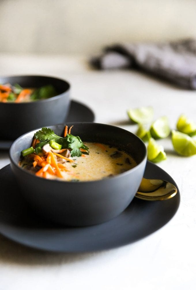 Vegetarian Thai coconut soup with lime slices