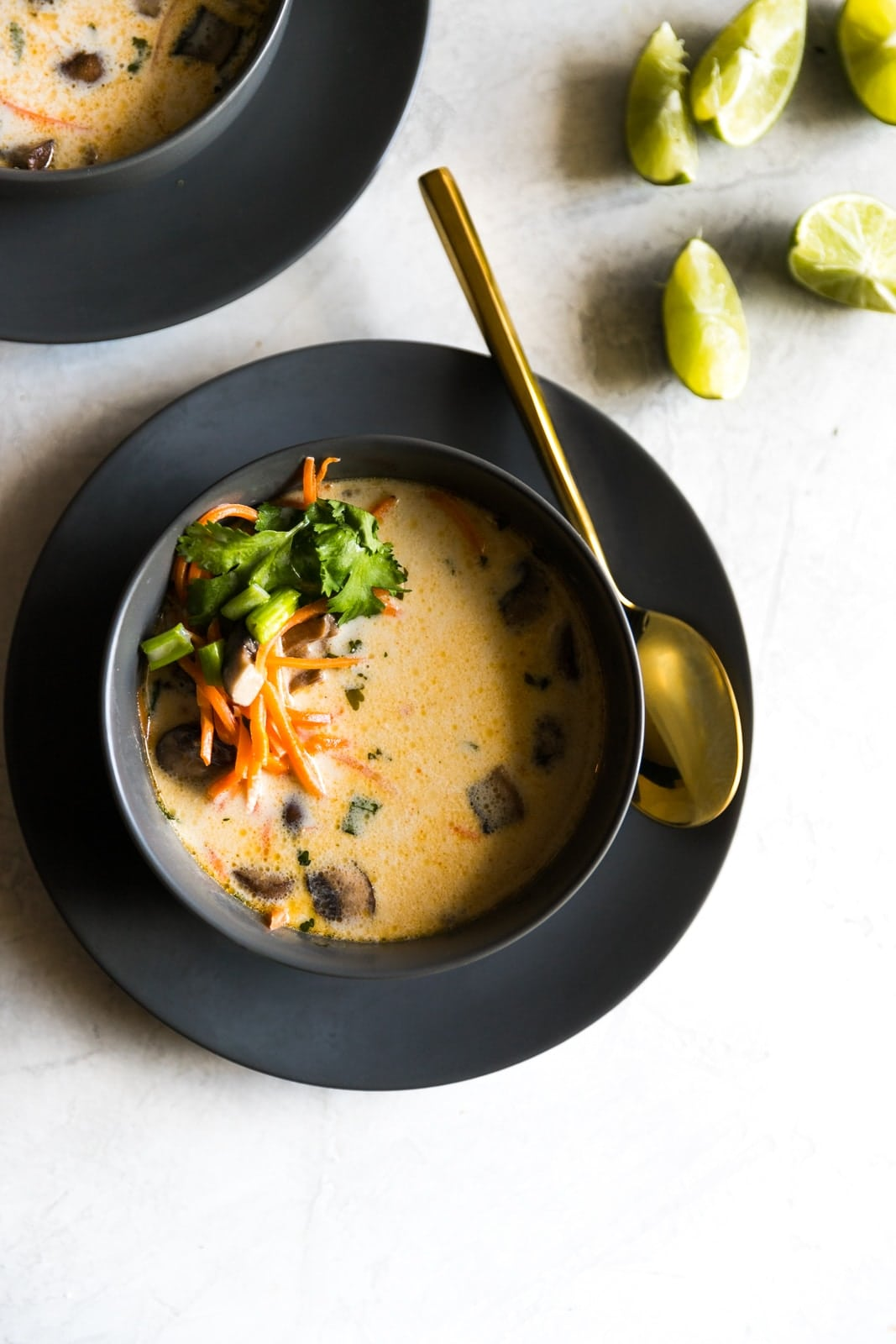 An easy, dairy-free, lightened up version of thai coconut soup made with coconut milk, ginger, spices and veggies. Perfect vegetarian weeknight dinner idea!