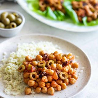 chickpeas recipe made Cuban-style on a plate with cauliflower rice