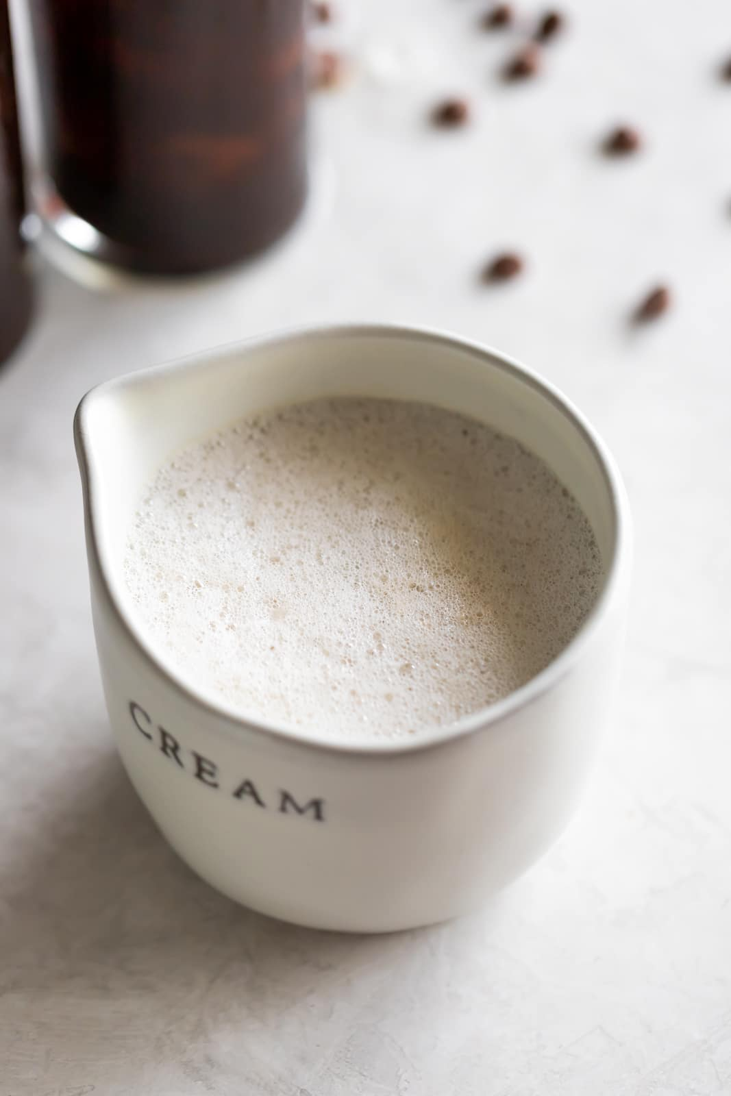A frothy dairy-free cafe con leche (milk with coffee drink) made iced with sweetened Cuban coffee, creamer, and almond milk.