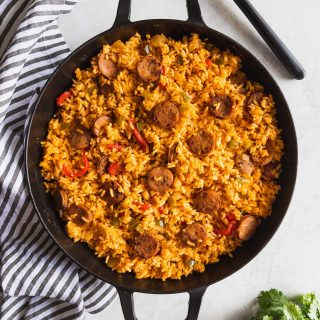 "A 30-minute version of the Cuban staple ""arroz con salchicha"" (Cuban-style yellow rice with Vienna sausages) using long grain rice, spices and chicken sausage."