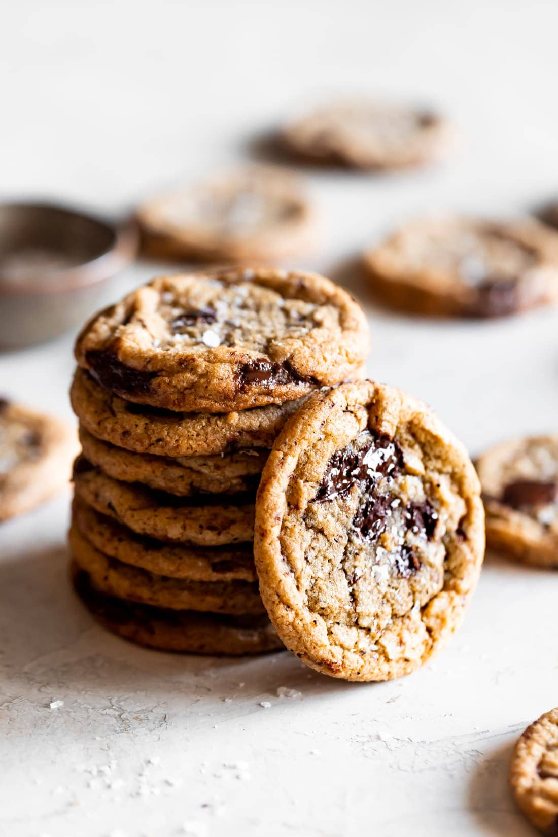 brown butter chocolate chip cookies stacked on top of each other on white background