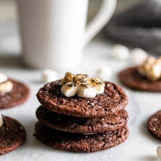 Boozy hot chocolate cookies! Rich, soft, and chewy chocolate cookies spiked with your favorite liqueur and topped with gooey torched mini marshmallows.