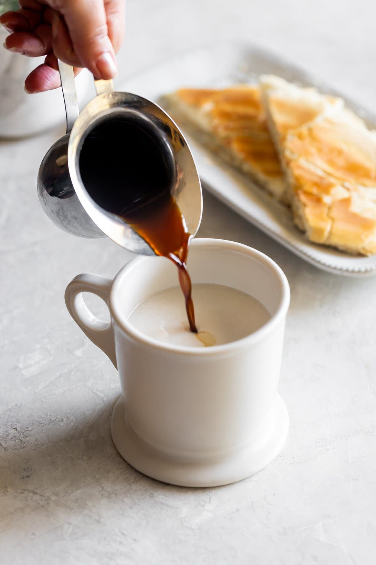 cuban coffee being poured into milk