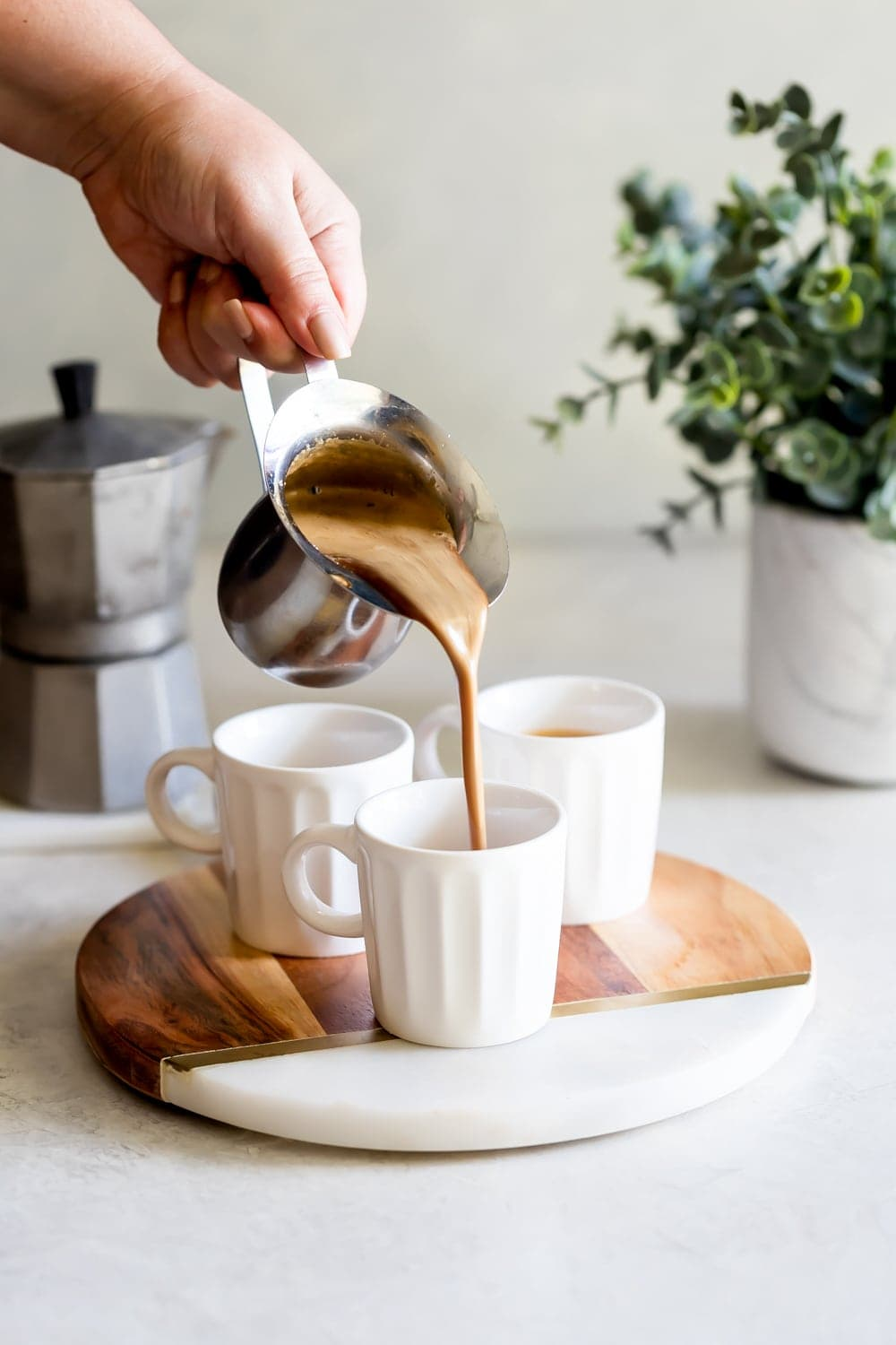 cuban coffee being poured into a espresso cups