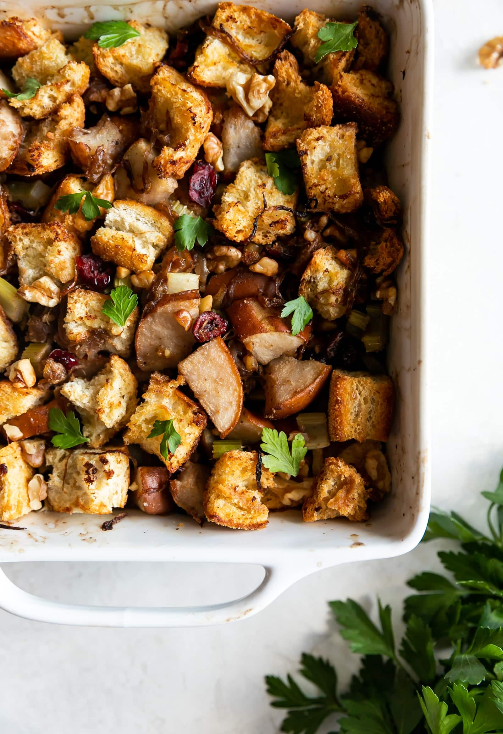 Caramelized Onion Pear & Walnut Stuffing. A flavorful and easy-to-make Thanksgiving stuffing made with caramelized onions, pears, celery, walnuts, and dried cranberries. #stuffing #thanksgiving