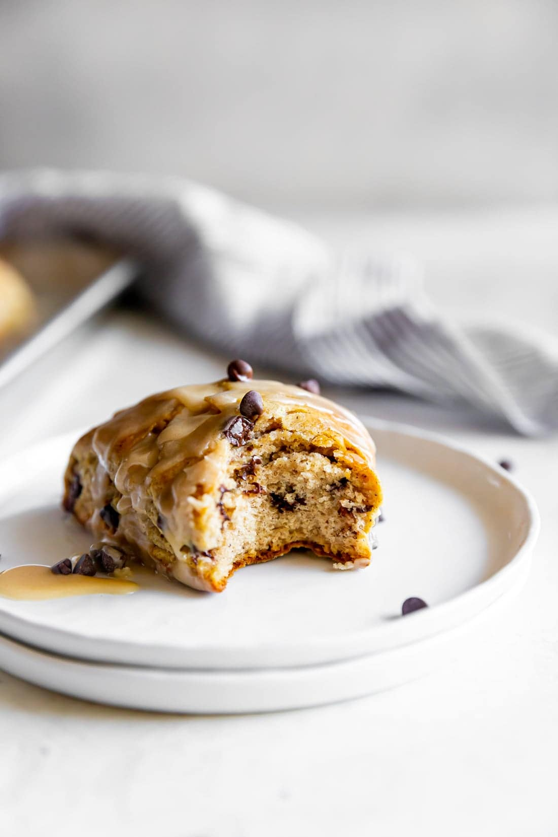 chai chocolate chip scone with espresso glaze with a bite taken out of it