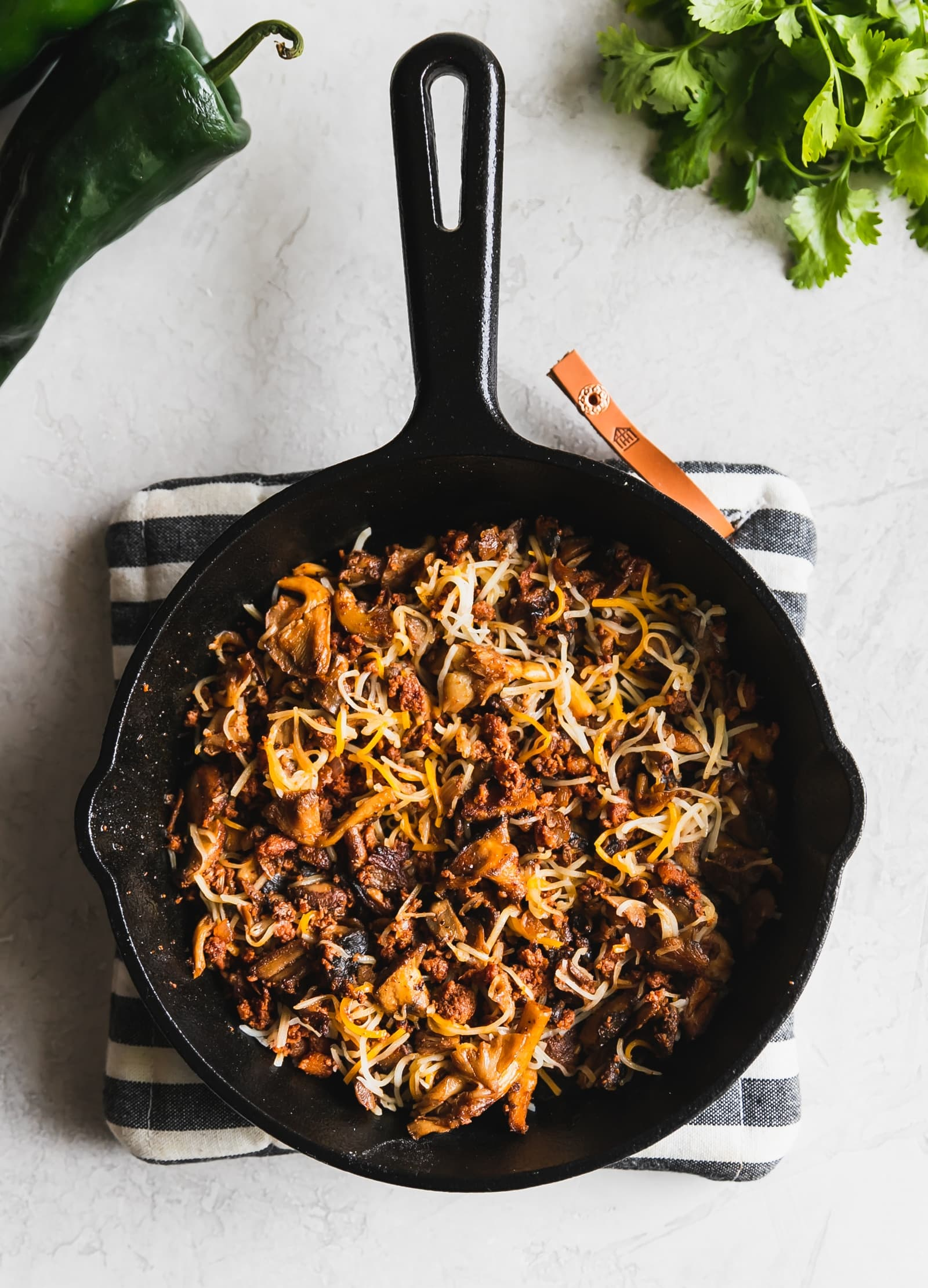 chorizo and mushrooms in a cast iron skillet