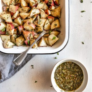 The easiest side dish ever. Roasted potatoes tossed in a delicious, super easy to make cilantro garlic chimichurri sauce!