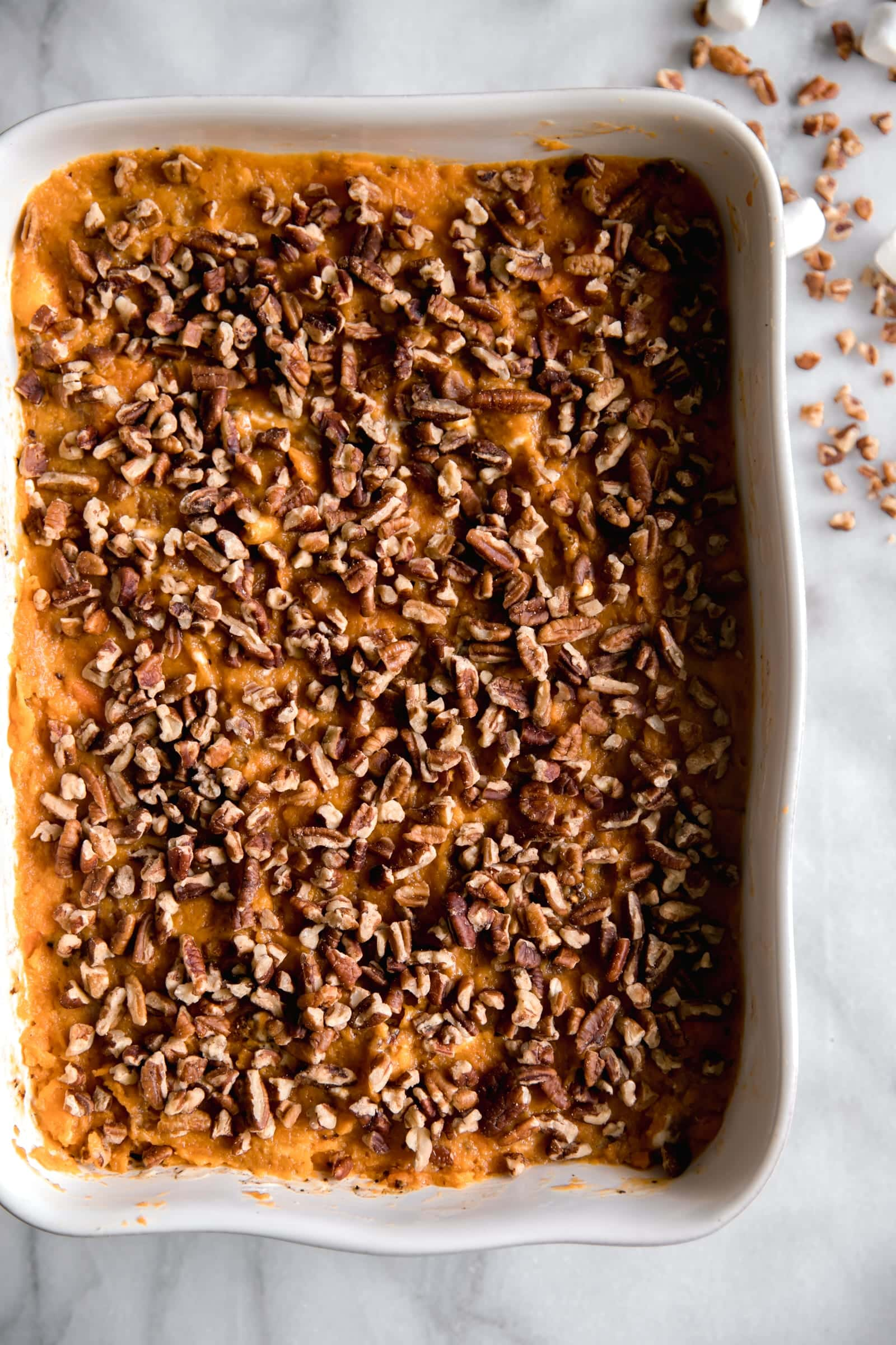 Layer of chopped pecans on top of sweet potato casserole
