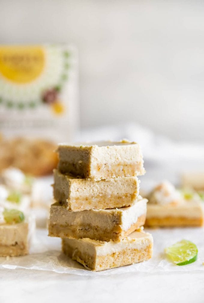 dairy-free coconut key lime pie bars stacked on top of each other