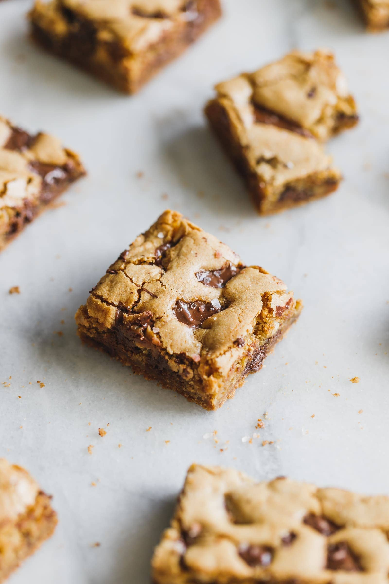 Incredibly soft, moist, thick and chewy chocolate chunk cookie bars made with coconut oil instead of butter, all in one bowl!