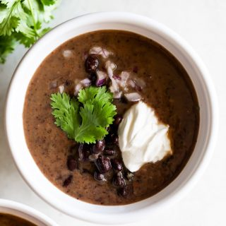 Rich, creamy, and easy-to-make Cuban black bean soup made with canned beans. Quick weeknight meal that is ready in just 25 minutes!