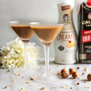 Creamy Hazelnut Cold Brew Martini. A rich velvety espresso martini with cold brew coffee, dairy-free hazelnut creamer, coffee liqueur, and vodka. The perfect pick-me-up for any day of the week!