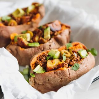 Sweet potatoes stuffed with Cuban-style lean ground beef, chopped sweet plantains, and avocado. A flavorful, easy-to-make 35-minute meal for busy weeknights!
