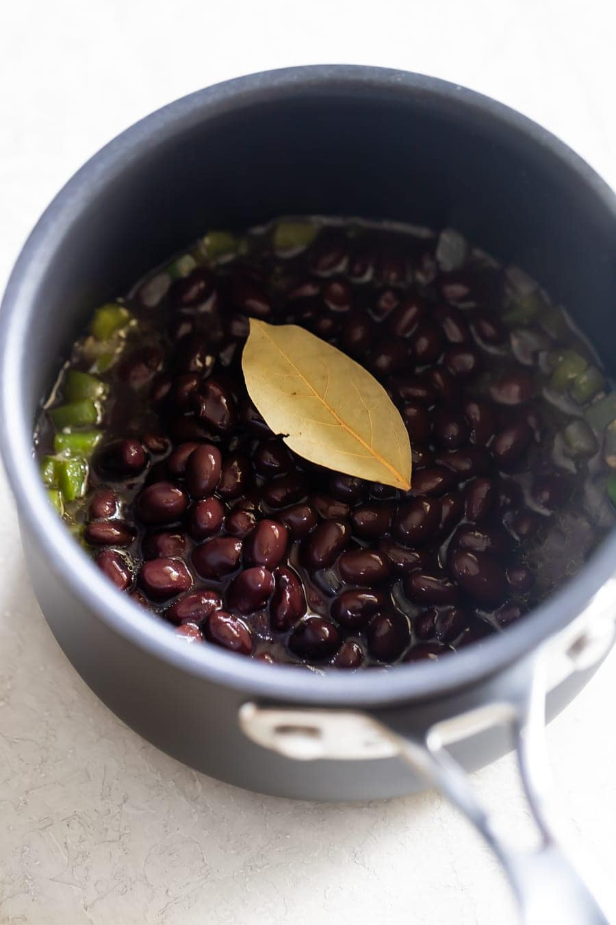 Cuban black bean recipe ingredients cooking in a pot