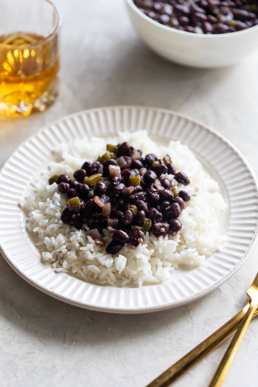 plate of white rice with black beans on a white plate