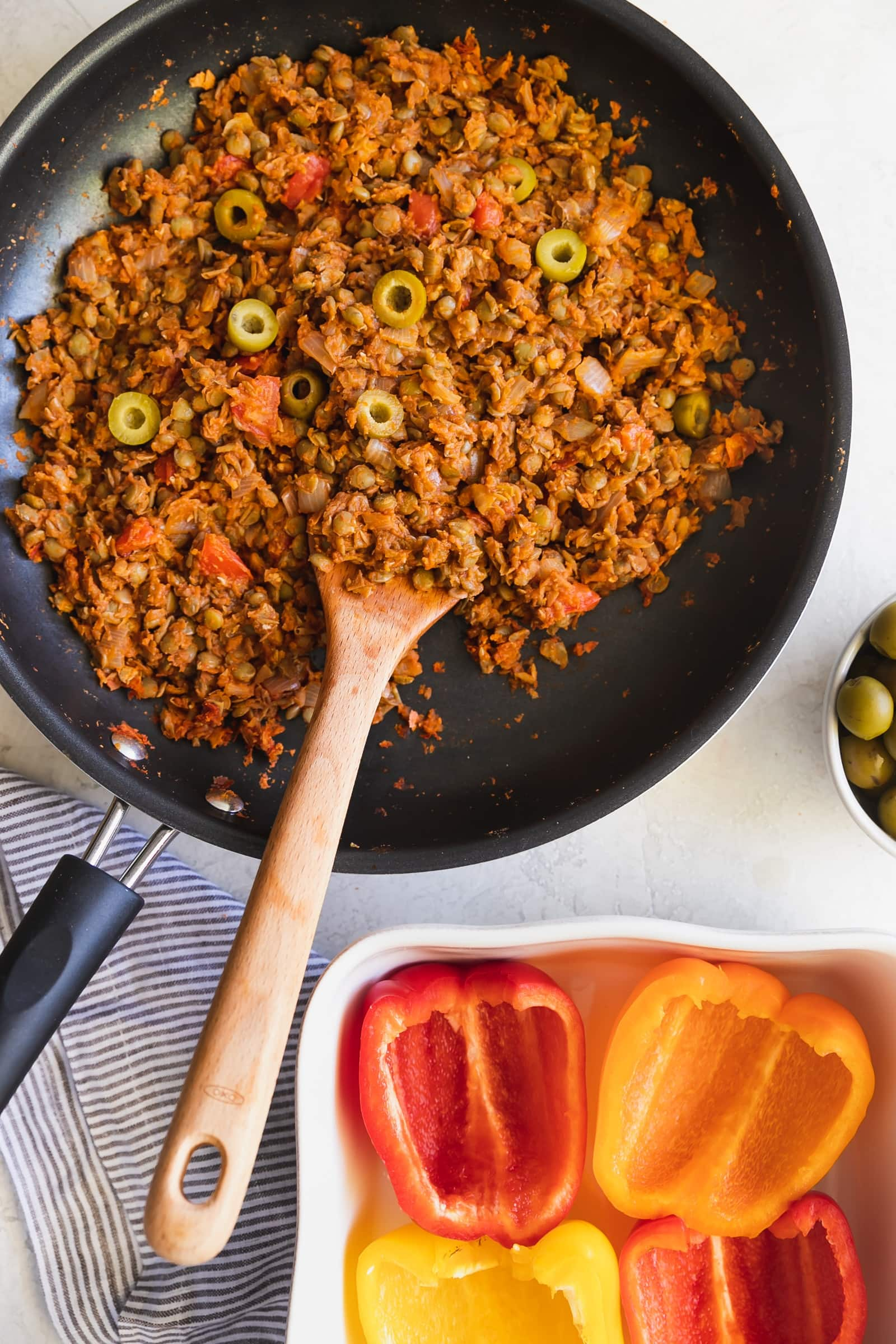 Cuban-Style Vegan Picadillo Stuffed Peppers. This vegan picadillo is a plant-based meal made Cuban-style with lentils, spices, onions, garlic, tomatoes, olives then stuffed in bell peppers. Perfect weeknight dinner!