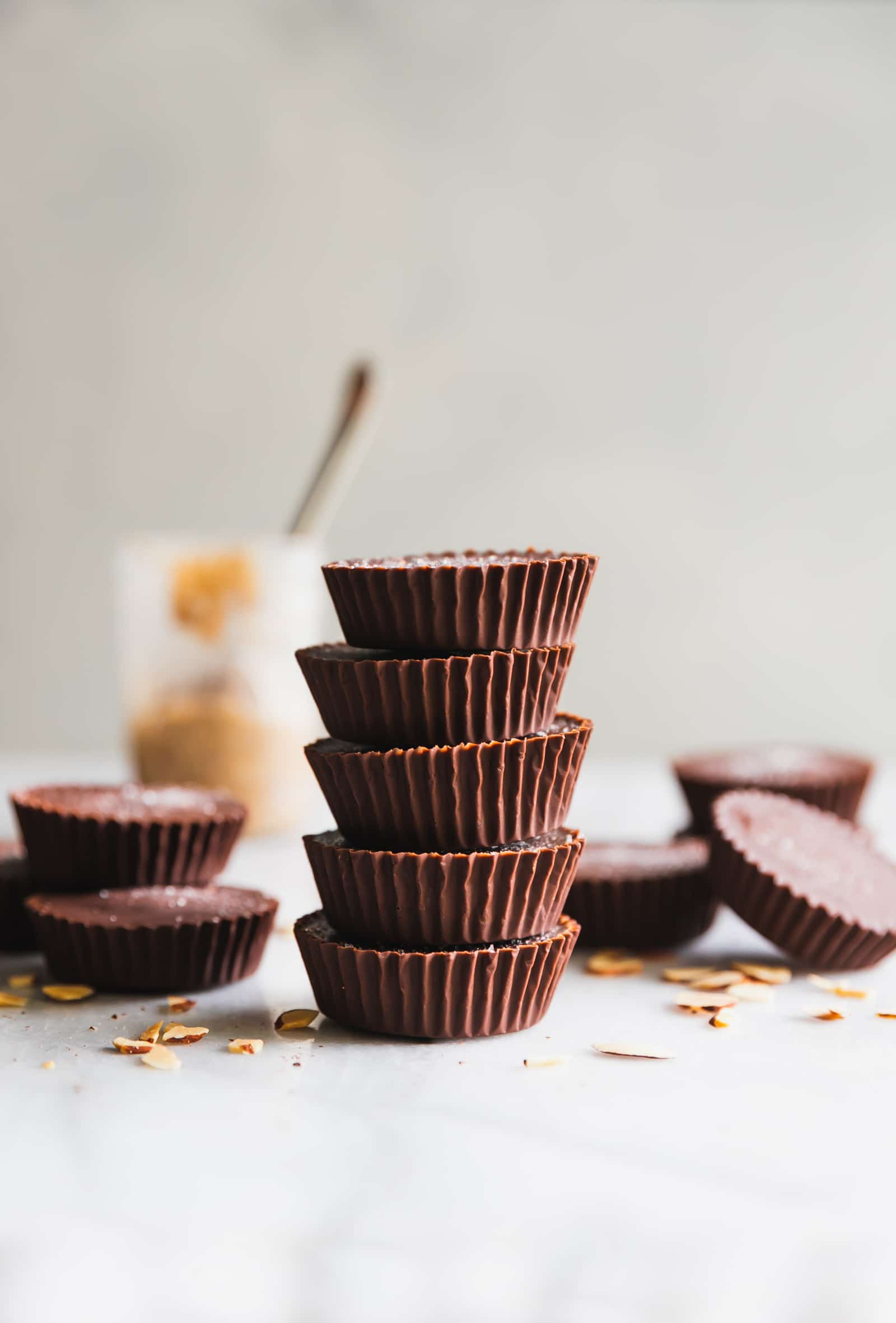 These rich and decadent almond butter cups are made with just 5 ingredients - dark chocolate, coconut oil, almond butter, chopped almonds, and sea salt. Perfect healthy-ish snack!