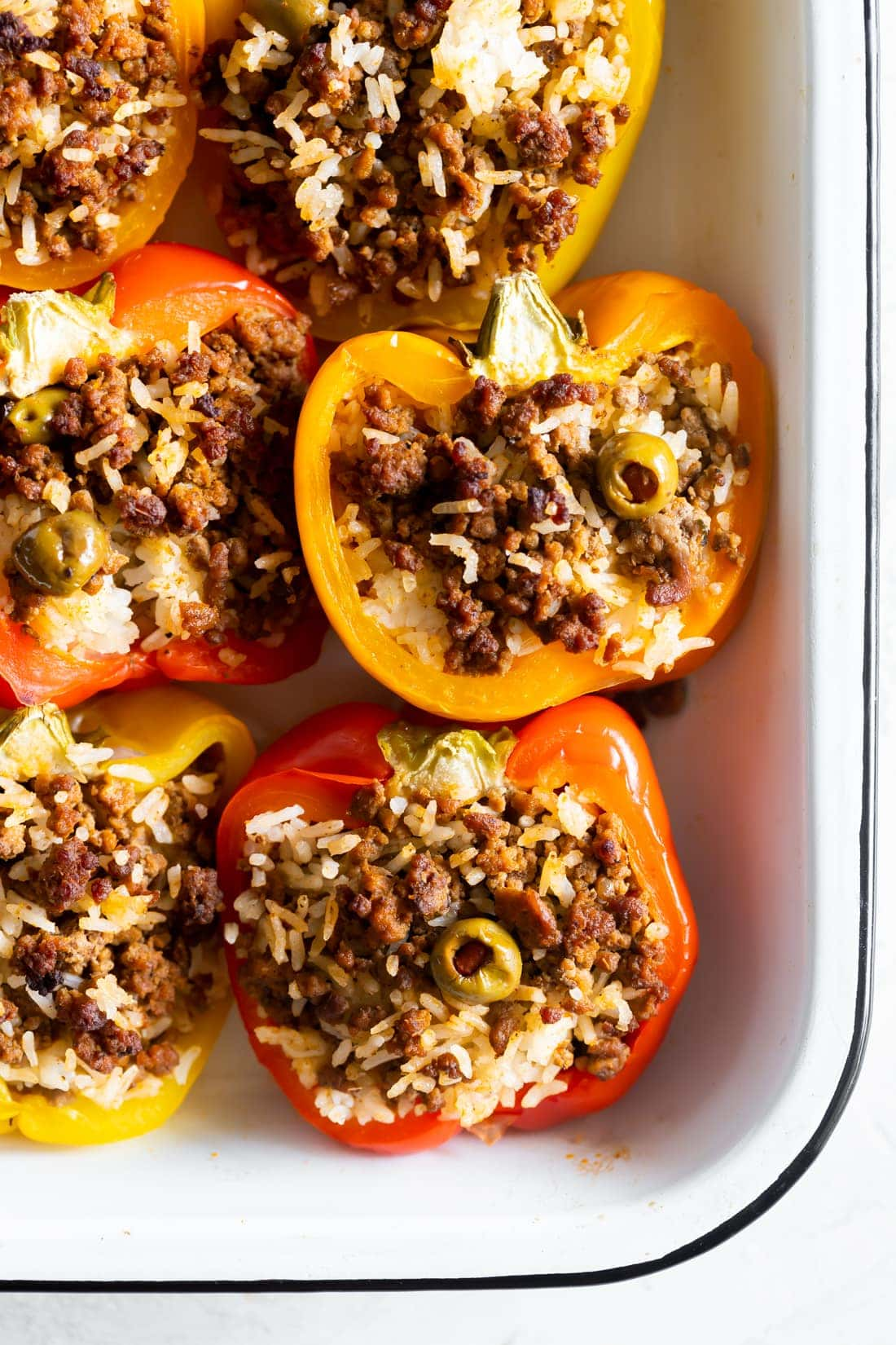 baking dish with cuban picadillo stuffed peppers