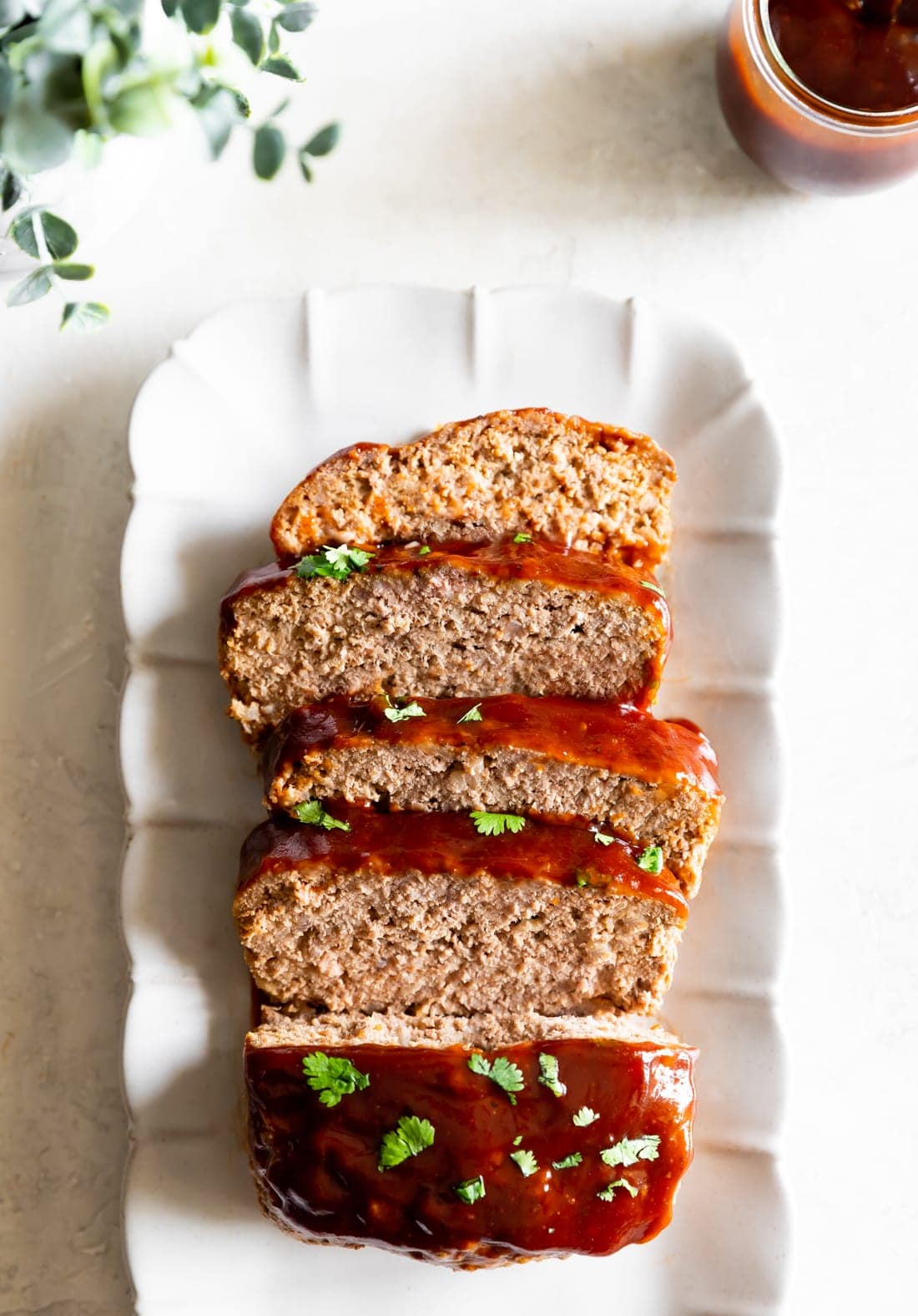 guava bbq sauce on meatloaf recipe sliced on a rectangular plate