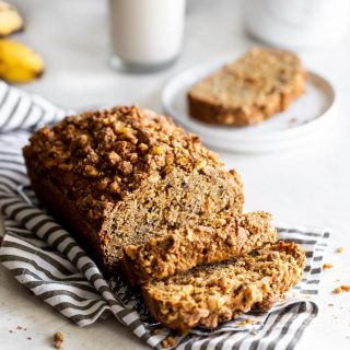Dairy-free, refined sugar-free, moist carrot cake banana bread made with wholesome ingredients and a crunchy walnut crumble topping!