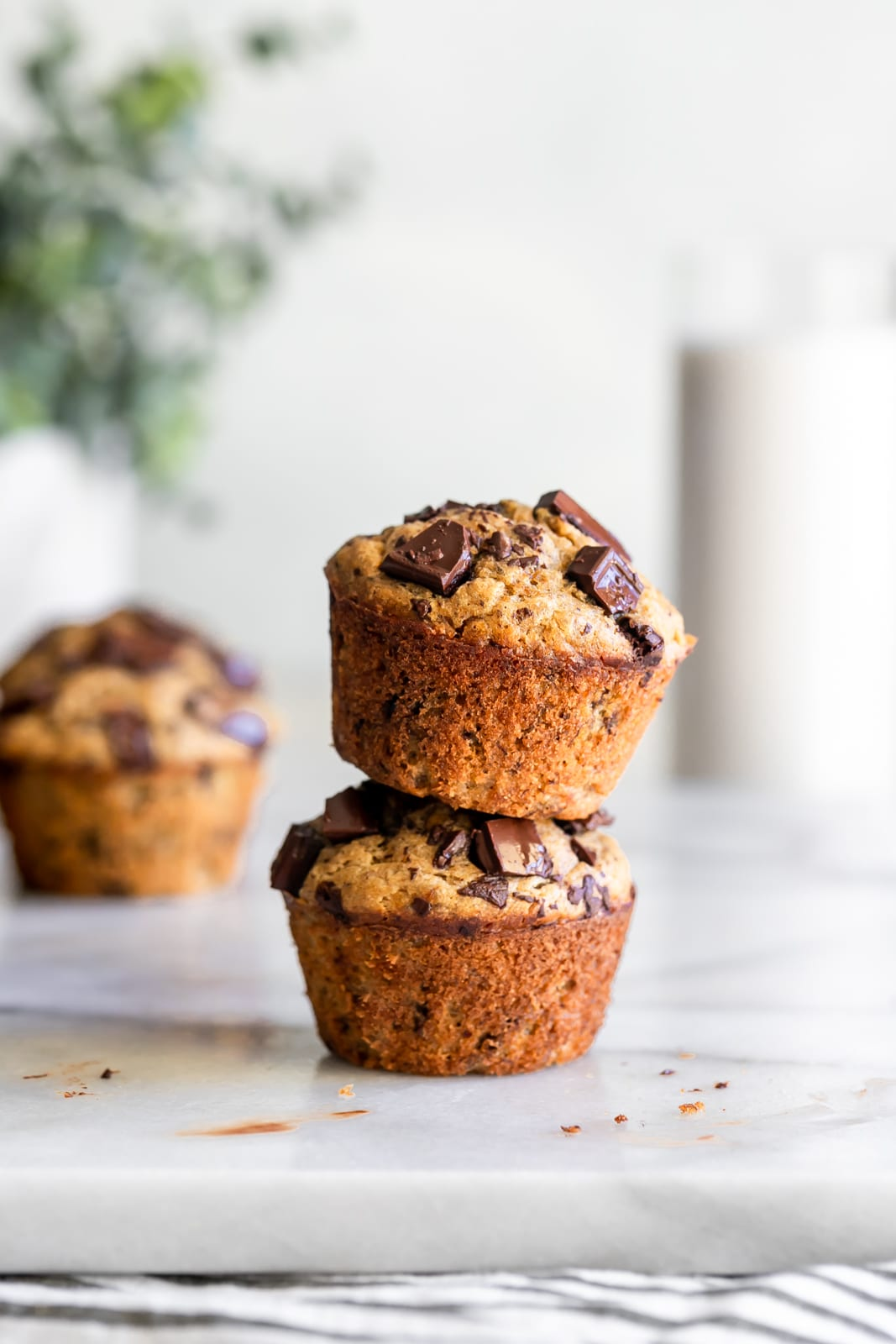 Two banana muffins stacked on top of each other