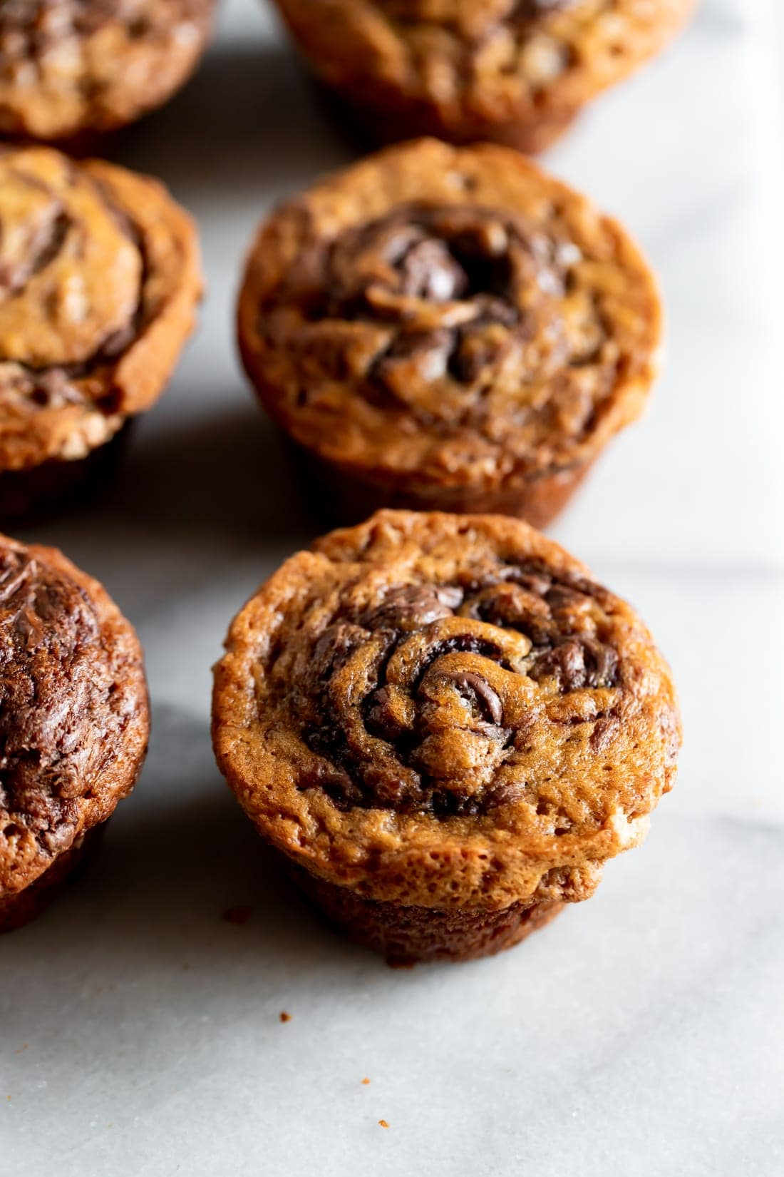 nutella banana muffins on a marble slab